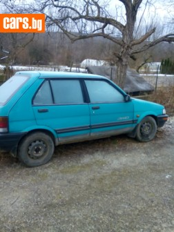 Subaru Justy 1.2i АГУ 4х4 photo