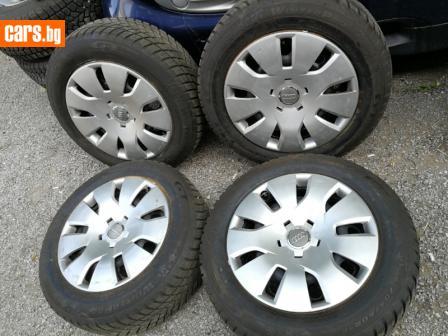 Ауди 16 цола стоманени джанти със зимни гуми ДОТ2418 и тасове  photo